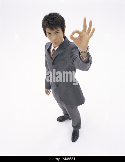 Businessman with OK sign - Stock Image