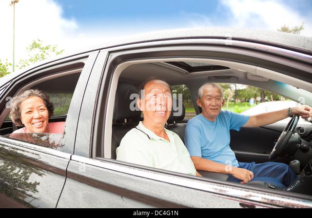 happy seniors enjoying road trip and travel - Stock Image