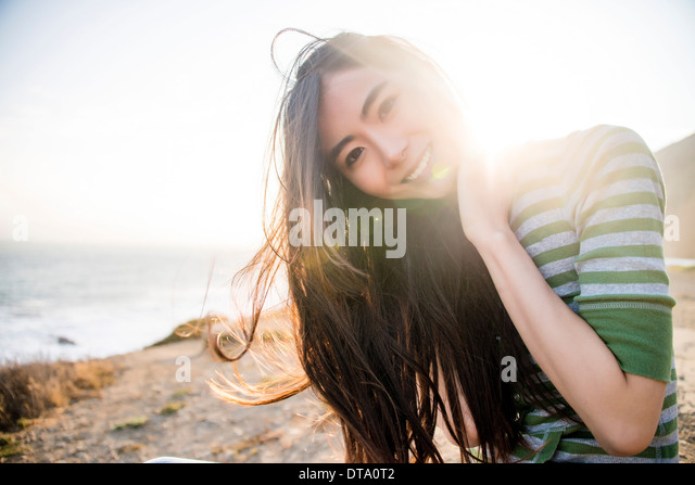 Smiling Woman on Beach - Stock Image