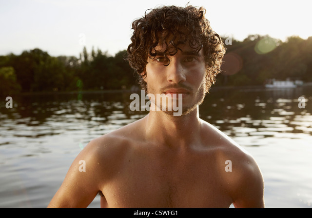 Germany, Berlin, Barechested man, portrait - Stock Image