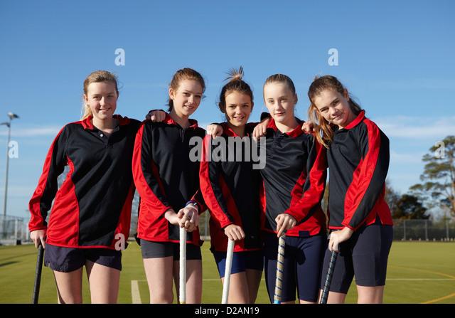 Lacrosse team smiling together - Stock Image