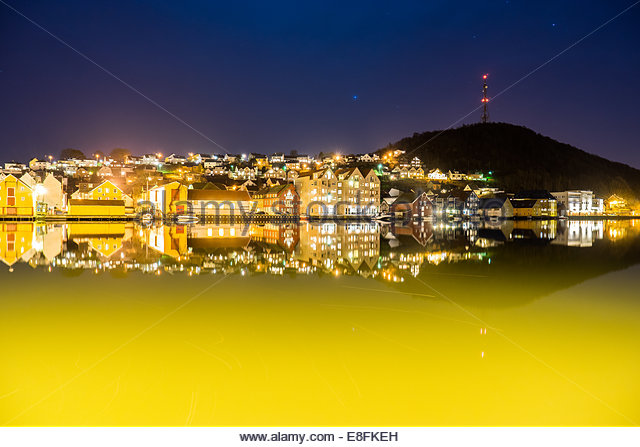 Norway, Rogaland, Egersund city by night, Varberg tower in background - Stock Image