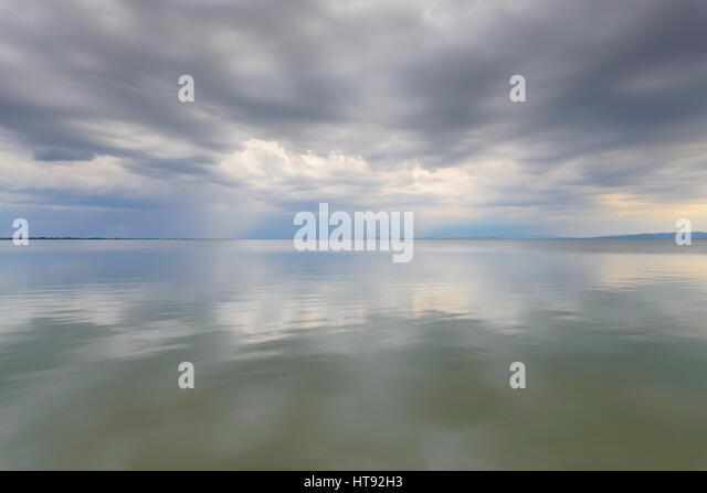 Clouds Reflecting in Lake Neusiedl at Weiden, Burgenland, Austria - Stock Image