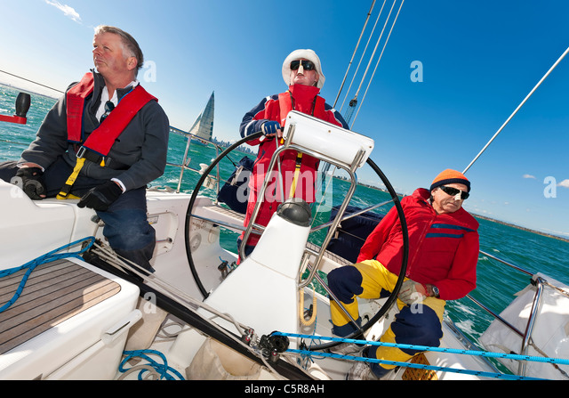 The captain at the wheel of an Ocean going yacht during race. - Stock-Bilder