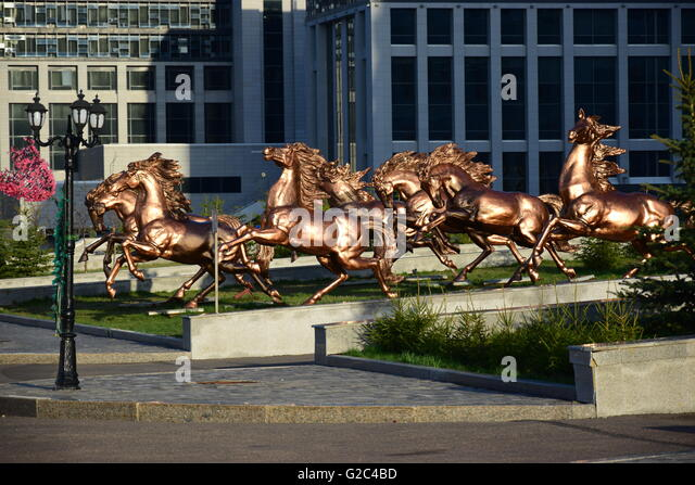 Bronze statue of horse in Astana, capital of Kazakhstan - Stock Image