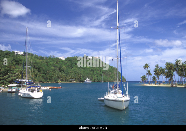 St Lucia Island Caribbean Marigot Bay scenic view coconut palms coastline sailboats beach - Stock Image