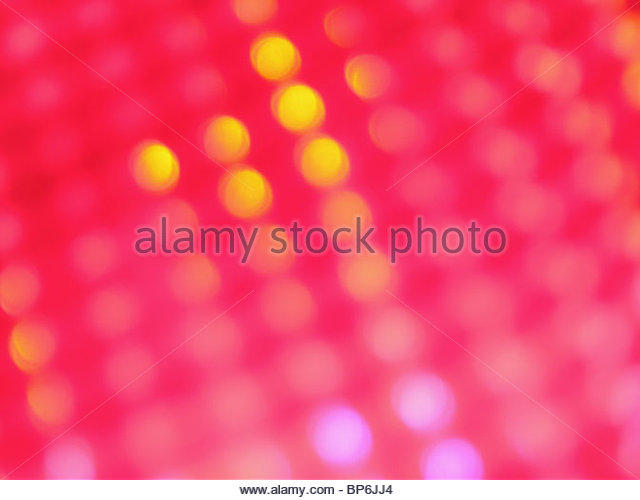 An abstract image of yellow, lilac and pink lights - Stock Image