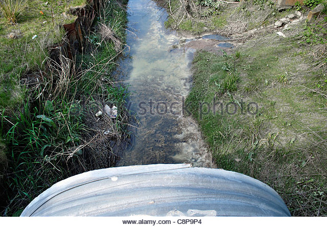 Waterway polluted by discharges from chemical industry. Widnes, Cheshire, UK - Stock Image