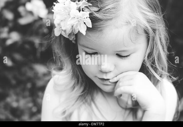 Portrait of a girl with flowers in her hair - Stock Image