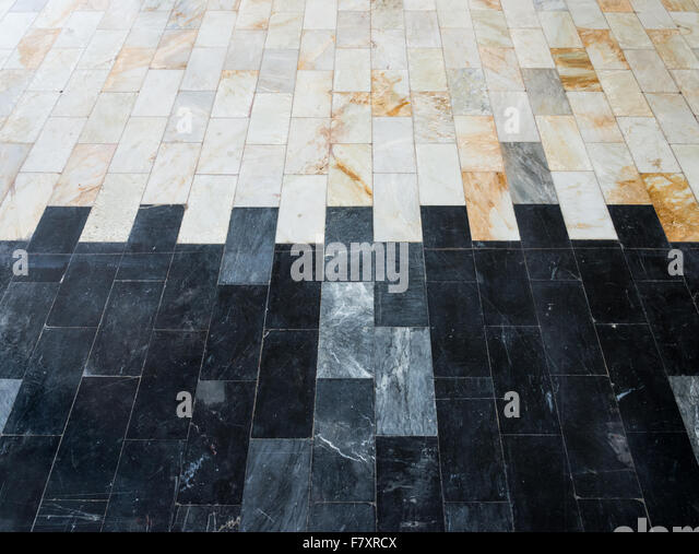 Duo tone marble tile of the house floor. - Stock Image