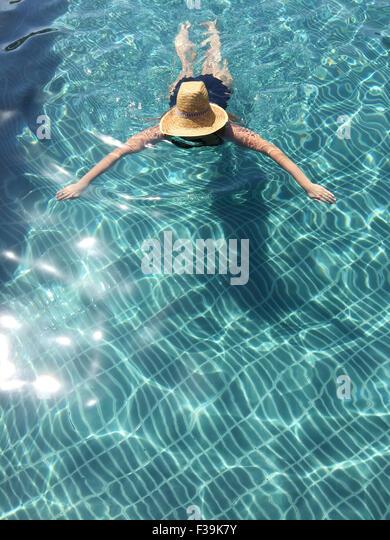 Woman swimming in swimming pool - Stock Image