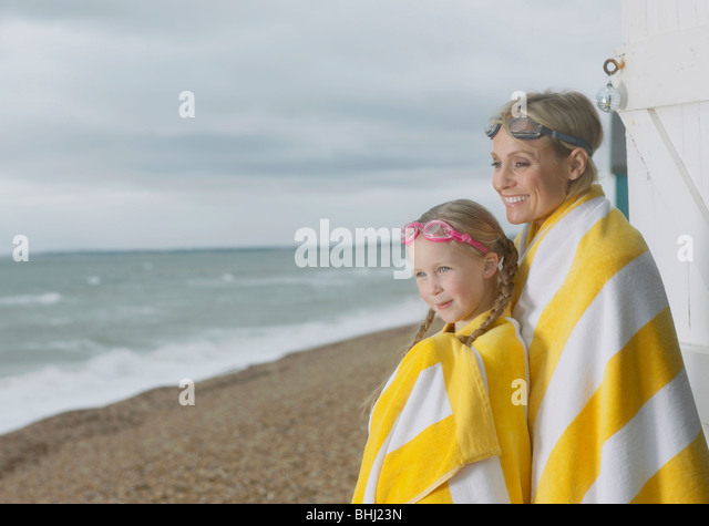 Mother and Daughter going for a swim - Stock Image