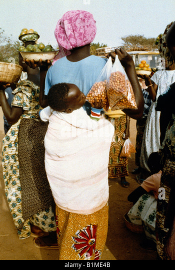 Senegal Mother Carrying Child On Back - Stock Image