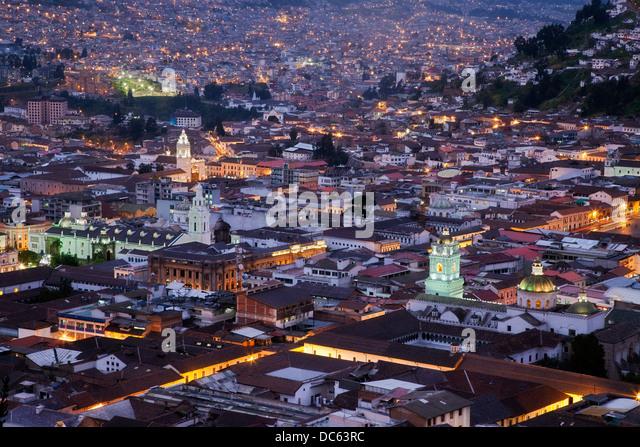 Quito illuminated at sunset, Ecuador - Stock Image