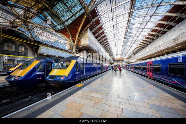Paddington station London platform with trains waiting for boarding - Stock Image