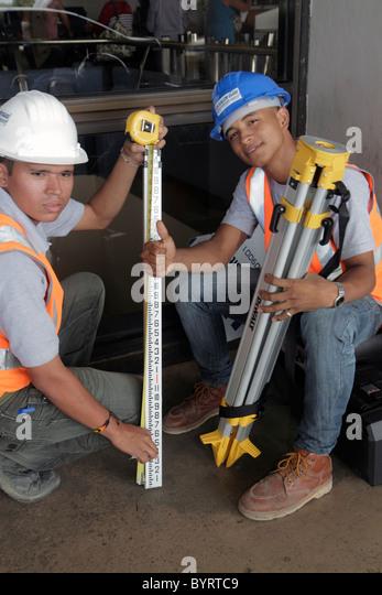 Panama City Panama Aeropuerto Tocumen airport PTY Hispanic man young adult worker job blue-collar construction laborer - Stock Image