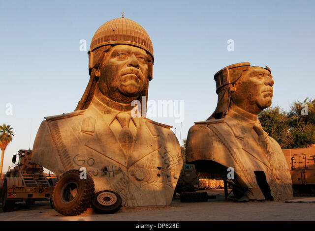 Jun 04, 2006; Baghdad, IRAQ; Toppled 20 foot statues of Saddam Hussein, taken from one of the former Iraqi President's - Stock-Bilder