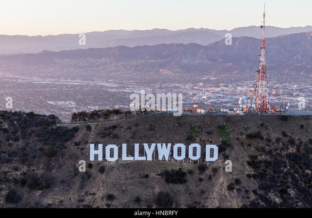Los Angeles, California, USA - July 21, 2016:  Late afternoon aerial of the Hollywood Sign in Griffith Park with - Stock Image