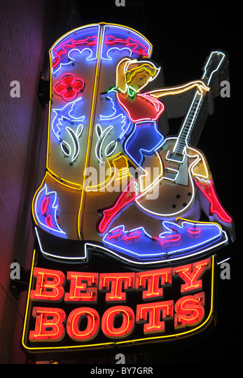Nashville Tennessee Music City USA downtown Lower Broadway business strip neon light sign Betty Boots western store - Stock Image