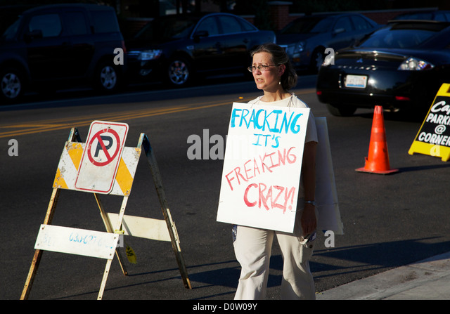 Woman wearing sign protesting fracking. Berwyn, Illinois. - Stock Image