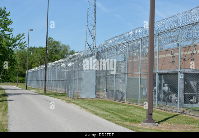 Perimeter fence at maximum security prison for juveniles in Omaha Nebraska. - Stock Image