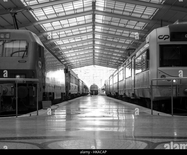 Harmony symmetry of lines train station b&w nostalgic feeling . Light and shadow inside every day train station - Stock-Bilder