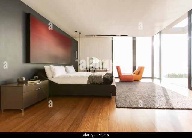 Rug and painting in modern bedroom - Stock-Bilder