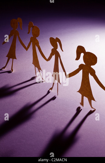Paper Chain girls, concept of Teamwork - Stock-Bilder