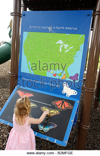 Indiana Valparaiso Butterfly Meadow theme playground girl preschooler child insects colorful sign interactive educational - Stock Image