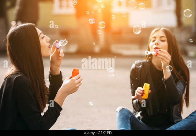 Two young adult girls - Stock Image