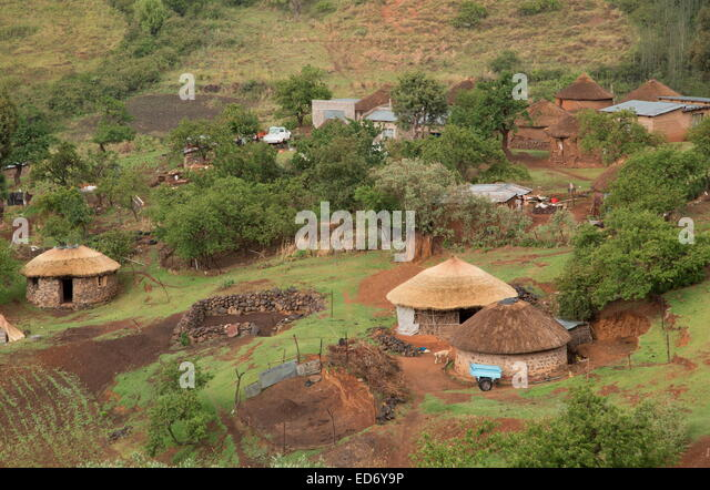 Basotho village with houses (mokhoro) in traditional Lesotho rondavel style. Drakensberg Mountains, Lesotho - Stock Image