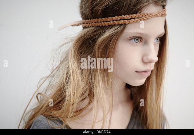 Portrait of girl wearing leather braid around head - Stock Image