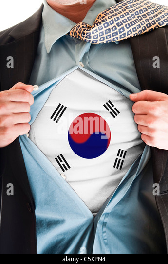 Business man showing South Korea flag shirt - Stock Image