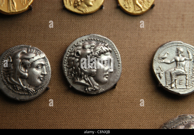 Ancient Greek coins of Alexander the Great from the numismatic collection of the Pergamon Museum in Berlin, Germany. - Stock Image
