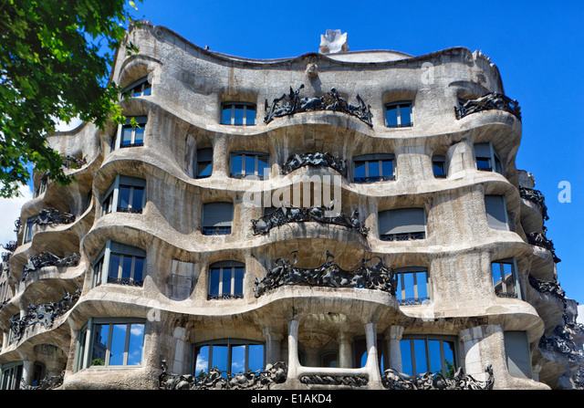 Low Angle View of a Building Facade, Casa Mila (La Pedrerea), Barcelona, Catalonia, Spain - Stock Image