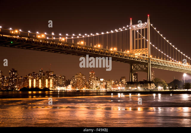 Beautiful view of the Ed Koch Queensboro Bridge in New York City looking towards Manhattan at night - Stock Image