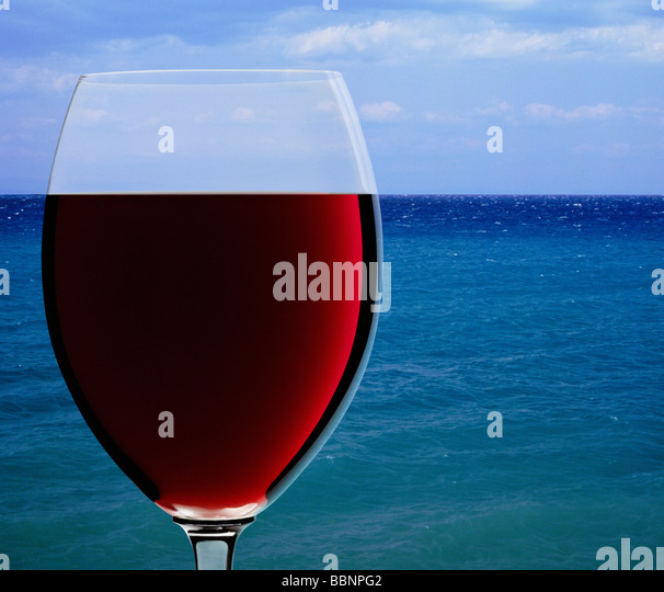 Wine glass on sea horizon - Stock Image