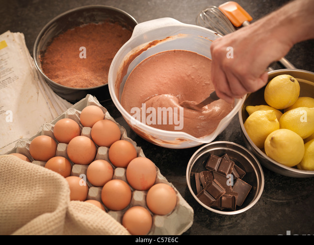 Cake mix and ingredients on counter - Stock Image