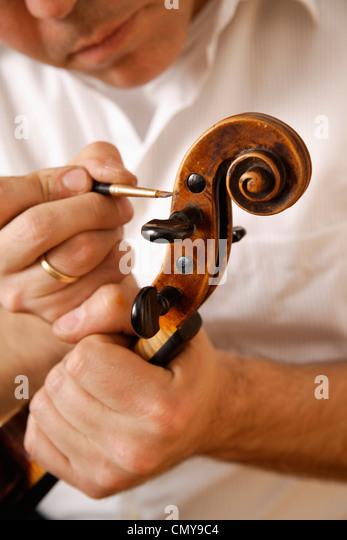 Germany, Upper Bavaria, Schaeftlarn, Violin maker making violin, close up - Stock Image