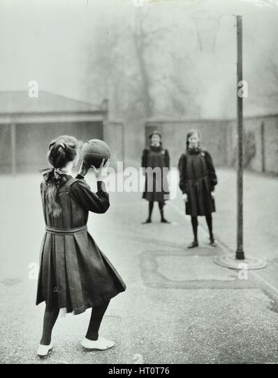 Girls playing netball, Chelsea Secondary School (Hortensia Road School), London, 1911. Artist: Unknown. - Stock Image