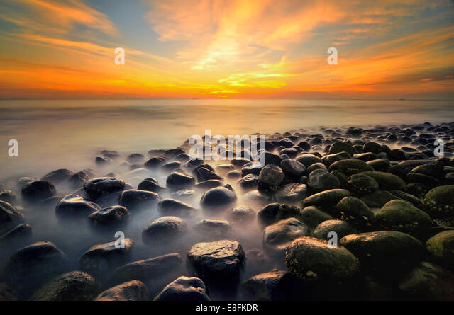 Malaysia, Pantai, Sunset at sea - Stock Image