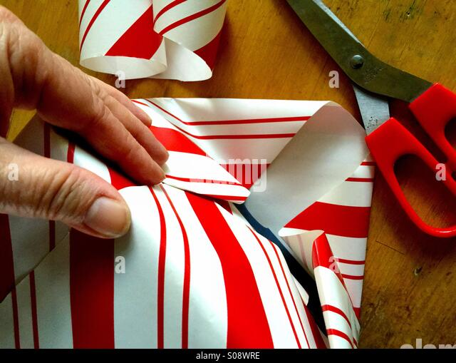 Wrapping Christmas present - Stock Image