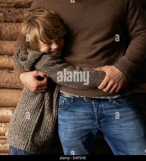 Smiling son hugging father - Stock-Bilder