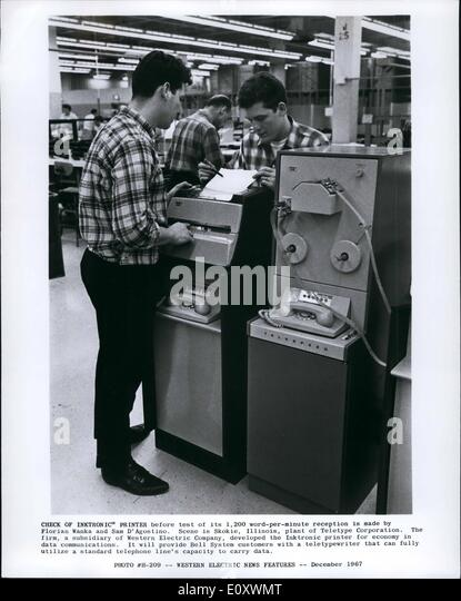 Dec. 12, 1967 - Check of Inktronic Printer before test of its 1,200 word per minute reception is made by Florian - Stock Image