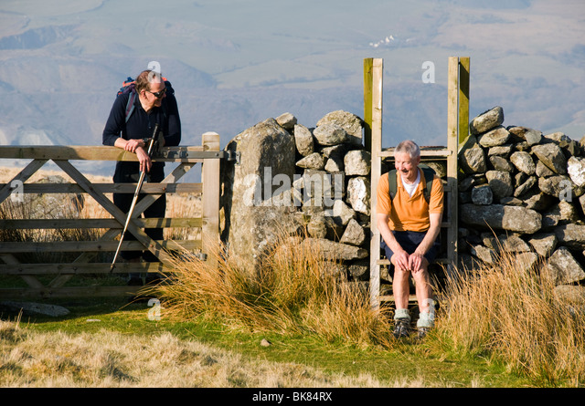 Two walkers chatting in Cwm Silyn, Snowdonia, North Wales, UK - Stock Image