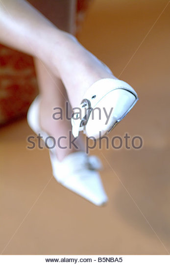 Feet in ladies shoes - Stock Image