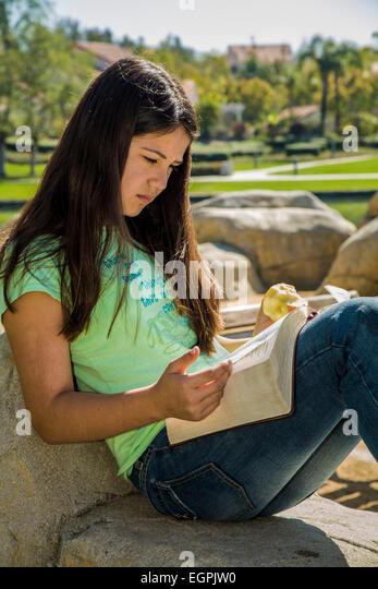 Hispanic Caucasian girl reading the Bible MR  © Myrleen Pearson - Stock-Bilder