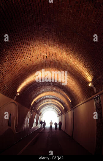 Italy, Monterosso, People walking in tunnel - Stock Image