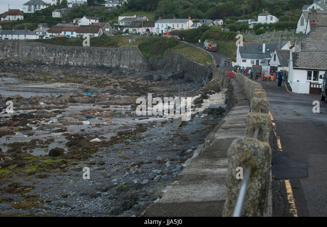 Coverack, Cornwall. 18th July 2017. Debris on beach from flash flood in coastal village of Coverack, Cornwall after - Stock Image