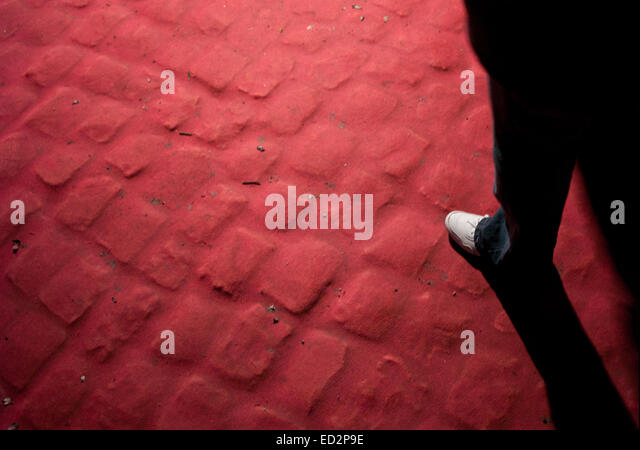 Walking on a red carpet - Stock Image